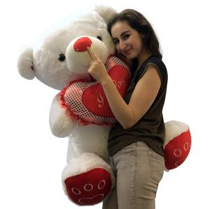 Huge teddy bearr carrying heart i love you